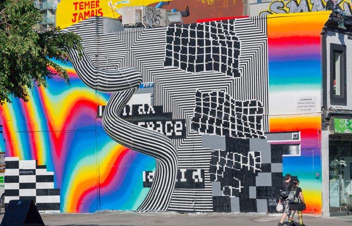 Dacă nu ți-ai testat niciodată retina pentru a vedea câtă culoare poate să tolereze, nu-i loc mai bun să o faci decât la festivalul Mural din Montreal
